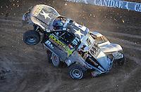Dec. 10, 2011; Chandler, AZ, USA;  LOORRS pro 2 unlimited driver Rob MacCachren (1) crashes after contact with Brian Deegan during round 15 at Firebird International Raceway. Mandatory Credit: Mark J. Rebilas-