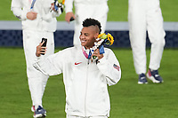 YOKOHAMA, JAPAN - AUGUST 6: Adrianna Franch #18 of the United States takes a selfie during the 2020 Tokyo Olympics Women's Soccer medal ceremony at International Stadium Yokohama on August 6, 2021 in Yokohama, Japan.