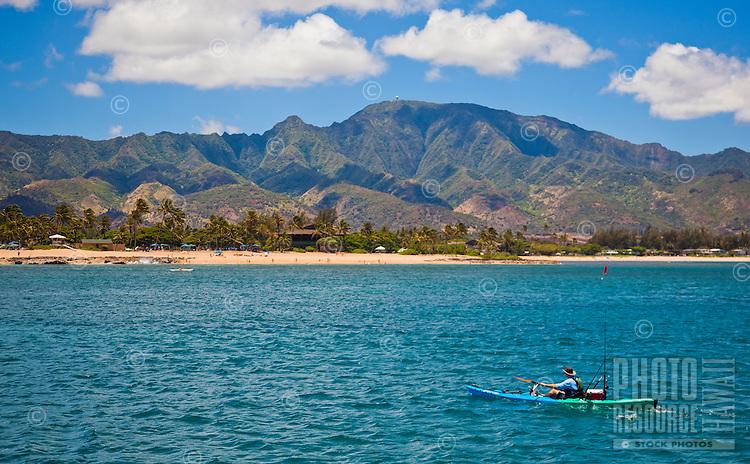 Man fishing on his kayak off the shores of Haleiwa