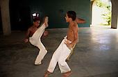 Rio de Janeiro, Brazil. Two youths practising capoeira.