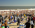 Crowds throng the beach at Rehoboth Beach, Delaware for the annual Polar Bear Plunge.