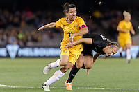 June 7, 2016: LISA DE VANNA (11) of Australia and KATIE DUNCAN (4) of New Zealand compete for the ball during an international friendly match between the Australian Matildas and the New Zealand Football Ferns as part of the teams' preparation for the Rio Olympic Games at Etihad Stadium, Melbourne. Photo Sydney Low