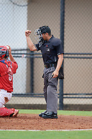 Umpire Chris Argueza calls a strike during a Gulf Coast League game between the GCL Yankees East and GCL Phillies West on August 3, 2019 at the Carpenter Complex in Clearwater, Florida.  The GCL Phillies West defeated the GCL Yankees East 15-7 in a completion of a game that was originally started on July 26, 2019.  (Mike Janes/Four Seam Images)