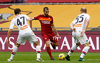 Roma's Henrikh Mkhitaryan, center, is challenged by Genoa's Milan Badelj, left, and Andrea Masiello during the Italian Serie A Football match between Roma and Genoa at Rome's Olympic stadium, March 7, 2021.<br /> UPDATE IMAGES PRESS/Riccardo De Luca