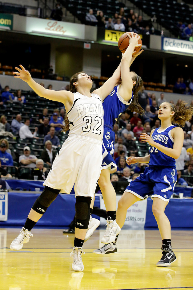 Penn guard Claire Carlton (32) competes for a rebound during the IHSAA Class 4A Girls Basketball State Championship Game on Saturday, Feb. 27, 2016, at Bankers Life Fieldhouse in Indianapolis.
