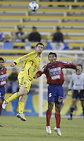 08 November 2006: CSD Municipal's Henry Medina, right, and Columbus Crew's Jason Garey jump for a header during the first half in Columbus, Ohio.<br />