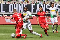 23rd May 2020, BORUSSIA-PARK, North Rhine-Westphalia, Germany; Bundesliga football, Borussia Moenchengladbach versus Bayer Leverkusen; Sven Bender (Leverkusen), Marcus Thuram (BMG), Charles Aranguiz (Leverkusen).