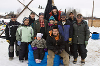 Nikolai checkpoint volunteers pose for a group photo during Iditarod 2008