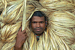 Jute workers with long flowing blonde hair by Saad Abdullah