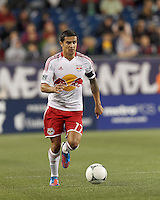 New York Red Bulls forward Tim Cahill (17) brings the ball forward. Despite a red-card man advantage, in a Major League Soccer (MLS) match, the New England Revolution tied New York Red Bulls, 1-1, at Gillette Stadium on September 22, 2012.