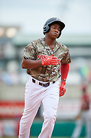Arkansas Travelers center fielder Chuck Taylor (31) rounds the bases after hitting a home run in the bottom of the third inning during a game against the Frisco RoughRiders on May 28, 2017 at Dickey-Stephens Park in Little Rock, Arkansas.  Arkansas defeated Frisco 17-3.  (Mike Janes/Four Seam Images)