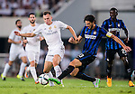 (L) Denis Cheryshev of Real Madrid CF competes for the balding (R) Andrea Ranocchia of FC Internazionale Milano during the FC Internazionale Milano vs Real Madrid  as part of the International Champions Cup 2015 at the Tianhe Sports Centre on 27 July 2015 in Guangzhou, China. Photo by Aitor Alcalde / Power Sport Images