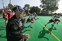 6 November 2007: Stanford Cardinal Alessandra Moss (42), Annika Alexander-Ozinskas (23), Midori Uehara (3), Lisa Maffucci (15), Caroline Hussey (18), Rachel Mozenter (7), assistant coach Mandy Hart (far left), and assistant coach Jordan Marotta (second from left) during Stanford's 1-0 win against the Lock Haven Lady Eagles in an NCAA play-in game to advance to the NCAA tournament at the Varsity Field Hockey Turf in Stanford, CA.