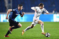 Robin Gosens of Atalanta BC and Luka Modric of Real Madrid compete for the ball during the Champions League round of 16 football match between Atalanta BC and Real Madrid at Atleti azzurri d'Italia stadium in Bergamo (Italy), February, 24th, 2021. Photo Image Sport  / Insidefoto