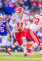 9 November 2014: Kansas City Chiefs quarterback Alex Smith looks to make a hand-off in the fourth quarter against the Buffalo Bills at Ralph Wilson Stadium in Orchard Park, NY. The Chiefs rallied with two fourth quarter touchdowns to defeat the Bills 17-13. Mandatory Credit: Ed Wolfstein Photo *** RAW (NEF) Image File Available ***