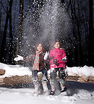 Twin Girl Sisters Playing in the Snow
