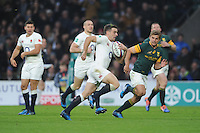 George Ford of England breaks for the line as Pat Lambie of South Africa attempts to catch him during the Old Mutual Wealth Series match between England and South Africa at Twickenham Stadium on Saturday 12th November 2016 (Photo by Rob Munro)