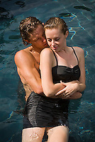 Young couple embracing in water