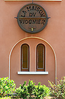 Domaine George Vernay's building in Condrieu with a sign decoration of an old oak barrel end carved with the text La Maison du Viognier - The House of Viognier. Condrieu, Rhone, France, Europe Domaine Georges Vernay