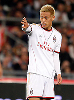 Calcio, Serie A: Roma vs Milan. Roma, stadio Olimpico, 25 aprile 2014.<br /> AC Milan forward Keisuke Honda, of Japan, gestures during the Italian Serie A football match between AS Roma and AC Milan at Rome's Olympic stadium, 25 April 2014.<br /> UPDATE IMAGES PRESS/Riccardo De Luca