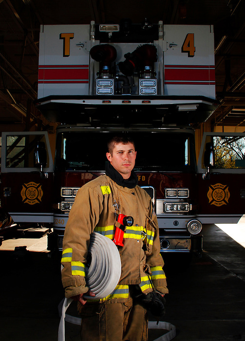 """Bowling Green, KY FireFighter Mark Carver, 27 years old, was hired 3 1/2 years ago. """"My dad was a fire fighter. I hated working in a cubicle and my dad suggested I apply, I did, and three years later they called me. It's as good a job a person could ask for"""", says Carver."""