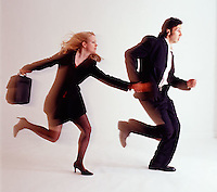 Man & woman couple holding hands running<br />