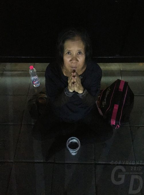 Poverty and a Beggar in the streets of Bangkok,Thailand