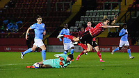 Manchester City U21's Cieran Slicker makes a save at the feet of Lincoln City's Harry Anderson<br /> <br /> Photographer Chris Vaughan/CameraSport<br /> <br /> EFL Papa John's Trophy - Northern Section - Group E - Lincoln City v Manchester City U21 - Tuesday 17th November 2020 - LNER Stadium - Lincoln<br />  <br /> World Copyright © 2020 CameraSport. All rights reserved. 43 Linden Ave. Countesthorpe. Leicester. England. LE8 5PG - Tel: +44 (0) 116 277 4147 - admin@camerasport.com - www.camerasport.com