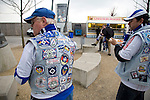 Manchester City 2 Hamburg SV 1, 16/04/2009. City of Manchester Stadium, UEFA Cup quarter-final. Two Hamburg fans with embroidered jackets eating a snack outside the City of Manchester Stadium, home to Manchester City FC, before the UEFA Cup quarter final second leg match with Hamburg SV. Several thousand fans of the German club made the trip to manchester to see their side progress to an all-German semi-final with Werder Bremen. Although Hamburg lost 2-1 in Manchester they went through 4-3 on aggregate after winning last week's first-leg 3-1. Photo by Colin McPherson.