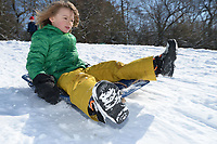 Murrell Craiglow, 7, of Fayetteville picks up speed Thursday, Feb. 18, 2021, as he heads downhill while sledding near North Street and College Avenue in Fayetteville. Visit nwaonline.com/210219Daily/ for today's photo gallery. <br /> (NWA Democrat-Gazette/Andy Shupe)