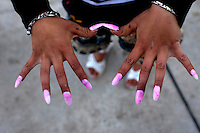 A woman shows her pink nails. Buzescu is known for it's ultra-wealthy Roma and their bizarre mansions that line the main street. The Roma of Buzescu are part of the Kalderash clan and are known for being coppersmiths and dealing with metal scraps. After the fall of the communist regime in the late 80's, they stripped old factories of their metals and some made a small fortune re-selling them. They are also known for making cazane, copper stills that produce alcohol such as palinka, a plum brandy.