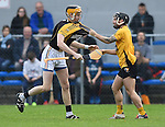 Brian Carrig of Ballyea and Cathal O Connell of Clonlara test each others jerseys during their senior county final replay at Cusack Park. Photograph by John Kelly.