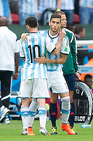 Lionel Messi of Argentina is replaced by Ricardo Alvarez of Argentina