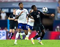 NASHVILLE, TN - SEPTEMBER 5: Richie Laryea #22 of Canada controls the ball during a game between Canada and USMNT at Nissan Stadium on September 5, 2021 in Nashville, Tennessee.