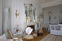 The marble fireplace and mirrored overmantel are a central feature of the open-plan living/dining room
