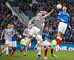 Big Brazilian Emilson Cribari is a tower of strength as he wins the ball from Ricky Little