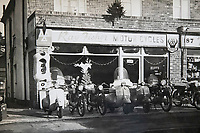 BNPS.co.uk (01202 558833)<br /> Pic: RayFisher/BNPS<br /> <br /> Pictured: Ray Fisher Motor Cycles in the 1960s.<br /> <br /> Tireless Ray Fisher still works full-time in the motorcycle shop he opened 62 years ago - and he has plenty left in the tank.<br /> <br /> The 85 year old founded Ray Fisher's Brickbits in Christchurch, Dorset, in 1959 after training as a bike mechanic.<br /> <br /> It is a family affair as his two children Gerry, 58, and Stephanie, 54, have both worked solely for him since leaving school aged 16.<br /> <br /> Ray said he had loved bikes since childhood and learnt how to repair them while doing national service in the early 1950s.