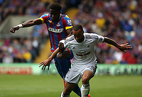 """Pictured L-R: Wilfried Zaha of Crystal Palace challenges Ashley """"Jazz"""" Richards of Swansea<br /> Re: Premier League match between Crystal Palace and Swansea City at Selhurst Park on Sunday 24 May 2015 in London, England, UK"""