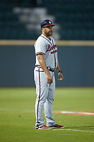 Rome Braves manager Matt Tuiasosopo (27) coaches third base during the game against the Columbia Fireflies at Segra Park on May 13, 2019 in Columbia, South Carolina. The Fireflies defeated the Braves 6-1 in game two of a doubleheader. (Brian Westerholt/Four Seam Images)