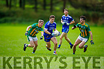 Annascaul's Cathal Ferriter in action as he slips past Lispoles Sean O'Nuanain and Cathal O'Se in the West Kerry Senior Championship.