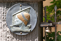Domaine Clos Marie. Pic St Loup. Languedoc. France. Europe. Sign and sculpture at the entrance gate.