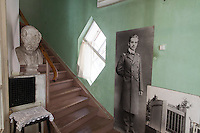 Moscow, Russia, 25/04/2013..A photograph of Konstantin Melnikov as a student inside the Melnikov House [1927-1929], the most famous construction by the Soviet avant-garde architect, in central Moscow. The house, which is slowly collapsing, is the subject of a complex dispute between the architect's grand-daughter Ekaterina, who lives there and wants to turn it into a museum, her sister Elena, and businessman Sergei Gordeev.