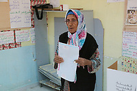 Tunisians cast their ballot at a polling station in the capital Tunis on October 6, 2019,