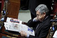 Massimo D'Alema mentre legge il giornale .Roma 25/01/2012 Voto alla Camera dei Deputati per la mozione unitaria sulla politica europea dell'Italia.Foto Insidefoto Serena Cremaschi