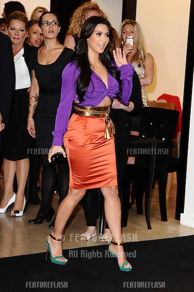 Kim Kardashian signs bottles of her new perfume 'Kim Kardashian' at Debenhams, Oxford Street, London. 08/06/2011 Picture by: Steve Vas / Featureflash
