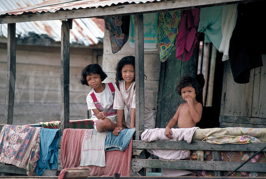Along the Musi River - which flows through Palembang, Indonesia, children & families live in shacks without electricity or water, yet they continue to survive despite such hard realities. child, poverty, house, home, economic, social conditions. Indonesia