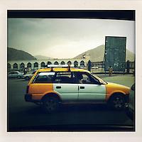 A Kabul taxi makes its way along a street.