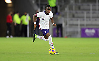 ORLANDO CITY, FL - JANUARY 31: Andres Perea #8 of the United States moves to the ball during a game between Trinidad and Tobago and USMNT at Exploria stadium on January 31, 2021 in Orlando City, Florida.