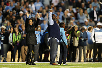 CHAPEL HILL, NC - NOVEMBER 02: Former University of North Carolina player Natrone Means is honored on the field during a game between University of Virginia and University of North Carolina at Kenan Memorial Stadium on November 02, 2019 in Chapel Hill, North Carolina.