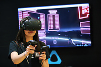 A young woman plays with the VR system